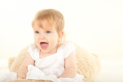 Pretty baby. Studio shot of blond little baby girl Royalty Free Stock Photography