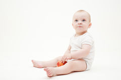 Pretty baby with apple Stock Photography