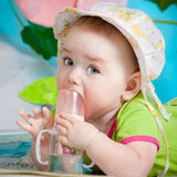 Pretty baby and baby bottle Royalty Free Stock Photo