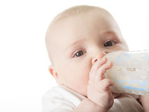 Pretty baby boy drinking milk from bottle Royalty Free Stock Photography