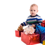 Pretty baby boy with gifts Royalty Free Stock Photography