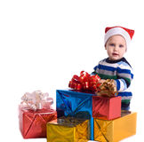 Pretty baby boy with  many gifts Stock Photos