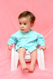 Pretty baby on chamber-pot Royalty Free Stock Photography