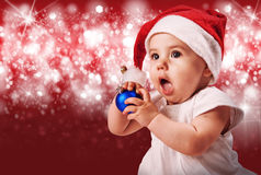 Pretty baby in christmas hat Stock Images