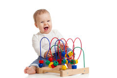 Pretty baby with color educational toy. Cheerful baby girl with color educational toy Stock Photos
