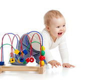 Pretty baby with color educational toy Royalty Free Stock Image