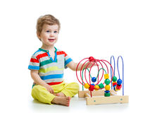 Pretty baby with color educational toy Royalty Free Stock Photos