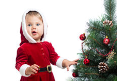 Pretty baby decorating Christmas tree isolated Stock Photos
