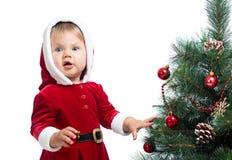 Pretty baby decorating Christmas tree isolated Stock Photos
