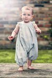 Pretty Baby Girl in Blue Jumpsuit Stock Photos