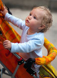Pretty baby-girl in carriage Royalty Free Stock Photo