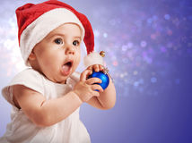 Pretty baby girl in christmas hat Stock Images