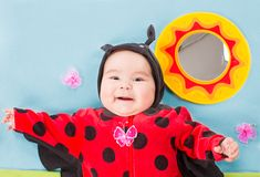 Pretty baby girl, dressed in ladybug costume Stock Photography