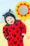 Pretty baby girl, dressed in ladybug costume Stock Photo
