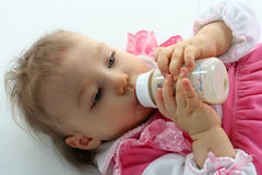 Pretty baby girl is drinking milk Royalty Free Stock Image