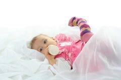 Pretty baby girl is drinking milk Stock Photos
