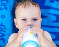 Pretty baby girl drinking milk Royalty Free Stock Image