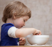Pretty baby girl eating Royalty Free Stock Photography