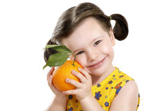 Pretty baby girl holding a big juicy orange Royalty Free Stock Photo