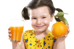 Pretty baby girl holding a big juicy orange. On white Stock Photo