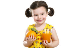 Pretty baby girl holding a big juicy orange Stock Photos