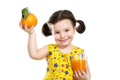 Pretty baby girl holding a big juicy orange Royalty Free Stock Image
