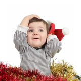 Pretty baby girl holding a santa claus hat Stock Image