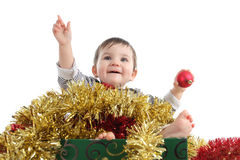 Pretty baby girl inside a box with christmas ornaments Royalty Free Stock Photos