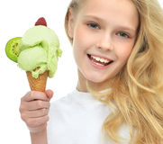 Pretty baby girl kid holding ice cream in waffles cone with rasp Royalty Free Stock Photos