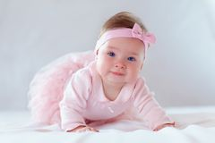Pretty baby girl in pink dress. Cute infant baby girl in pink dress Stock Images