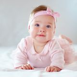 Pretty baby girl in pink dress stock image