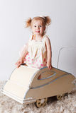 Pretty baby girl in a pram Stock Photos