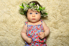 Pretty baby girl wearing a flower head wreath Royalty Free Stock Photos