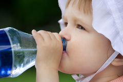 Pretty baby have water. From plastic bottle Stock Photo