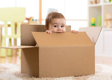 Pretty baby inside a box royalty free stock images