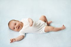 Pretty baby  is lying on the carpet Royalty Free Stock Photo