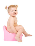 Pretty baby and pink potty Royalty Free Stock Photos