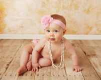 Pretty baby playing dress up Royalty Free Stock Photos