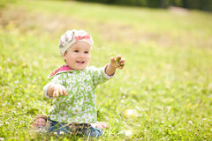 Pretty baby is playing in the park Royalty Free Stock Photos