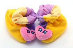 Pretty baby's pair of first shoes. Pretty baby's pair of first colorful with heart shoes on white isolated background Royalty Free Stock Photography
