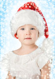 Pretty baby in santa claus christmas red hat Royalty Free Stock Photo