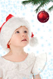 Pretty baby in santa claus christmas red hat. Baby in santa claus christmas red hat and snowflake and starlet Royalty Free Stock Photography