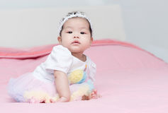 Pretty baby sit on pink blanket. Pretty girl baby sit on pink blanket Royalty Free Stock Image