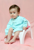 Pretty baby sitting on chamber-pot Royalty Free Stock Photo
