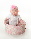Pretty Baby Sitting In A Hatbox Stock Images