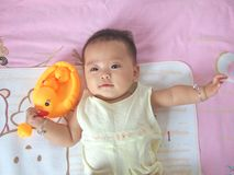 Pretty baby and toy ducks stock photography