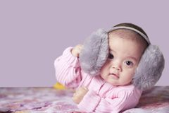 Pretty baby wearing headset royalty free stock image