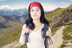 Pretty backpacker standing on the mountain Royalty Free Stock Images