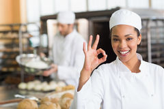 Pretty baker smiling at camera. In the kitchen of the bakery Royalty Free Stock Photo