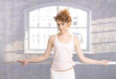 Pretty ballerina girl standing by bar practicing Royalty Free Stock Photography